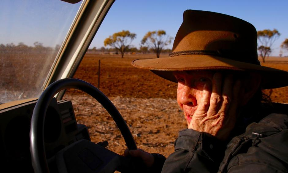 May McKeown, an Australian farmer, drives her truck to feed the remaining cattle on her drought-affected property in July. Photo: David Gray, Reuters