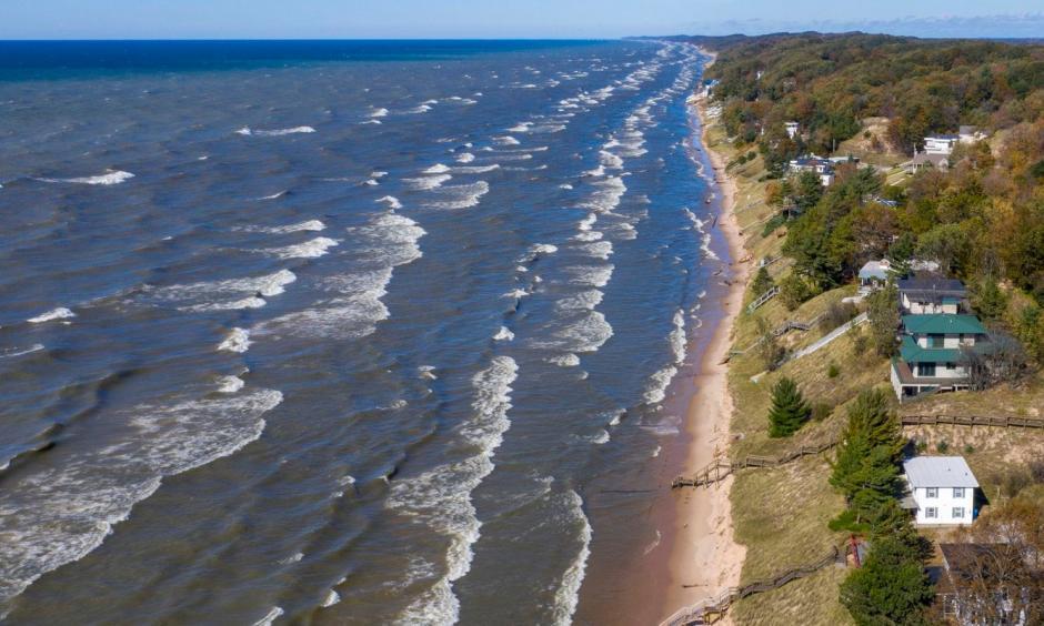 Lake Michigan waves batter the shoreline and cause erosion along North Shore Estates Road in Ferrysburg, Mich., on Oct. 23. Credit: Cory Morse, The Grand Rapids Press, AP