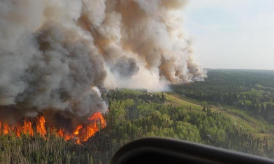 An aerial view of the flames roaring north of Fort McMurray on Tuesday afternoon. Photo: CBC News