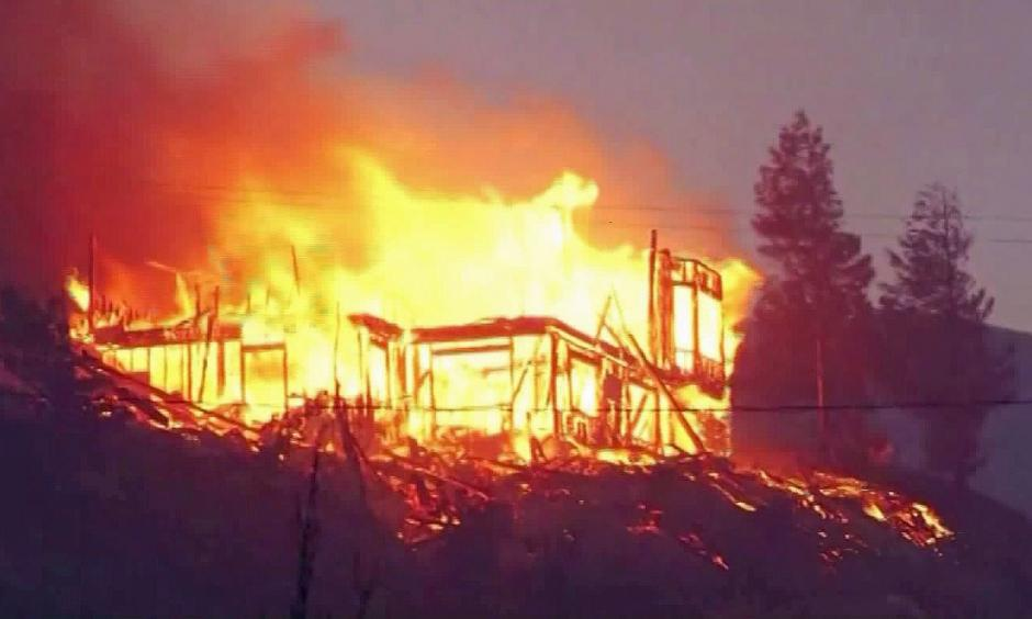 Flames from the Erskine fire tear through a house in the Lake Isabella area. Photo: KBAK via CNN