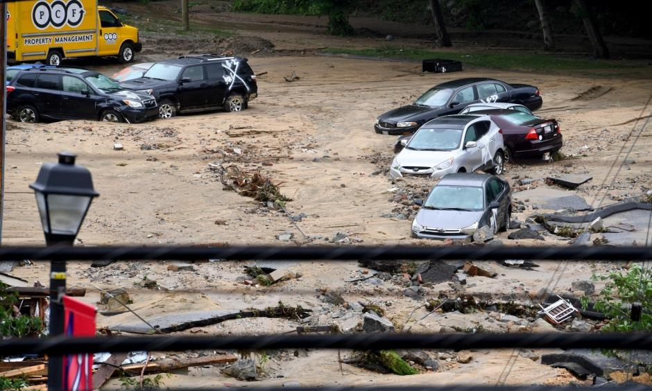 Destroyed parked cars are stranded in the mud May 28 in Ellicott City, Md. This comes two years after another flash flood killed two people and devastated the historic downtown. Photo: Katherine Frey, The Washington Post