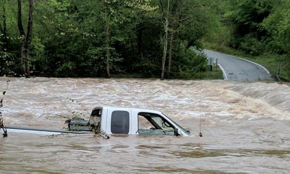 Rescuers found the driver of this truck on top of the vehicle when they arrived Monday morning in Wilkes County, North Carolina. Heavy rain is causing flooding in the Carolinas and Virginia. Photo: WXII/Bethany Moore