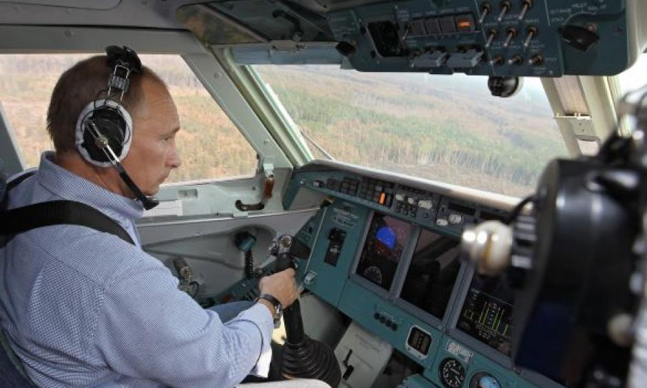 Prime Minister Vladimir Putin fighting forest fires in the Ryazan region on Tuesday from the co-pilot's seat of an amphibious plane. He doused two fires, media reported. Photo: RIA-Novosti, AP