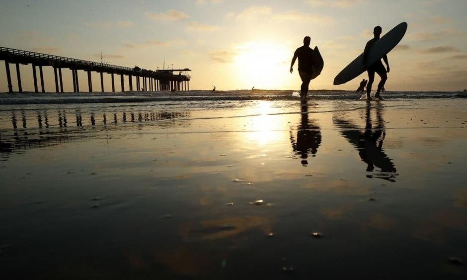 Surfers at Scripps Pier on Thursday in San Diego. Photo: Gregory Bull, AP
