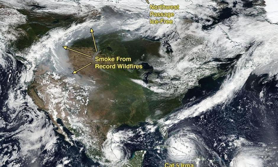 The future was now in 2017. In a scence that climate scientists say we should see more of in a future warmer climate, the GOES-16 satellite image from September 8, 2017 showed multiple intense hurricanes in the Atlantic, along with smoke from large wildfires and an ice-free Northwest Passage. Image: Weather Underground | Category 6