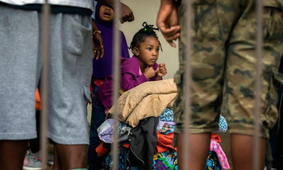 An unidentified little girl waits with her family at the Savannah Civic Center to evacuate from he path of Hurricane Irma, Saturday, Sept., 9, 2017 in Savannah, Ga. Photo: Stephen B. Morton, AP