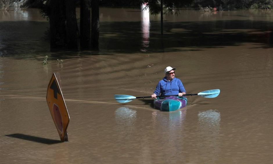 On the last day of meteorological winter—February 28, 2019—a kayaker paddles through a flooded neighborhood in Guerneville, California. The town was under mandatory evacuation and roads leading into the town have been flooded over, after an atmospheric river event brought torrential rains to central California and inundated the Sierra with heavy snow. Photo: Justin Sullivan, Getty Images