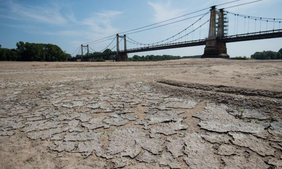 A dry part of the bed of the River Loire at Montjean-sur-Loire, France, on July 24, 2019, as drought conditions prevail over much of western Europe. Credit: Loic Venance, AFP, Getty Images