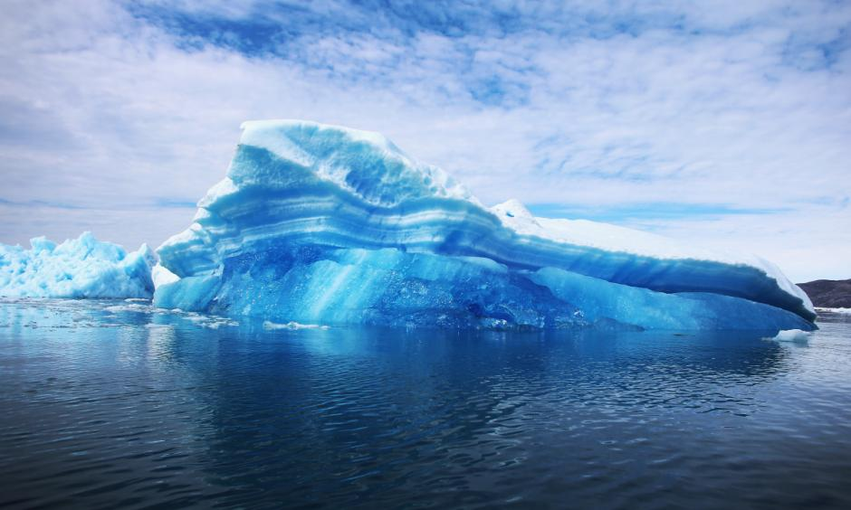 Calved icebergs from the nearby Twin Glaciers are seen floating on the water in Qaqortoq, Greenland. Photo: Joe Raedle, Getty Images