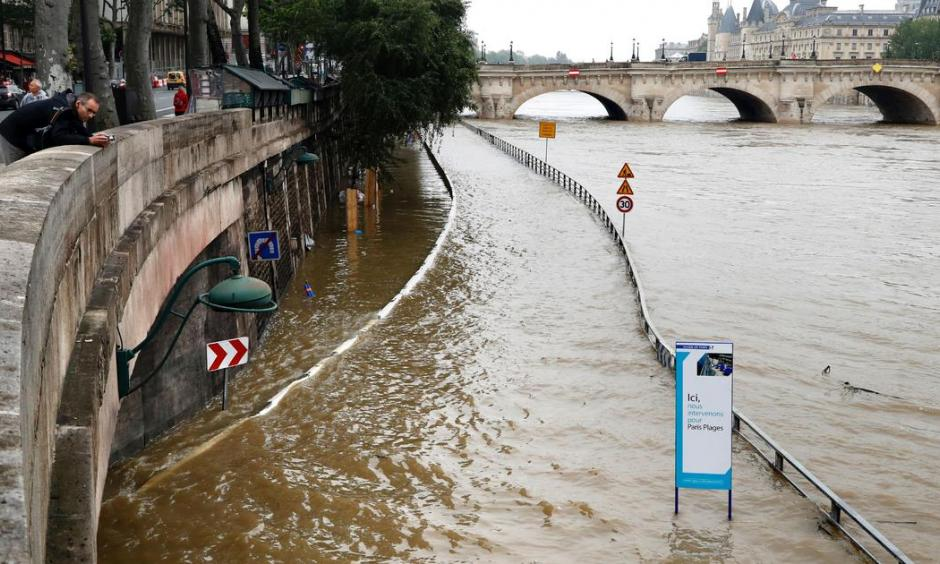 A man watches the flooded expressway along the Seine near the Pont Neuf (rear) after its banks became flooded, following heavy rainfalls on June 1, 2016 in Paris. Photo: Francois Guillot, AFP, Getty Images