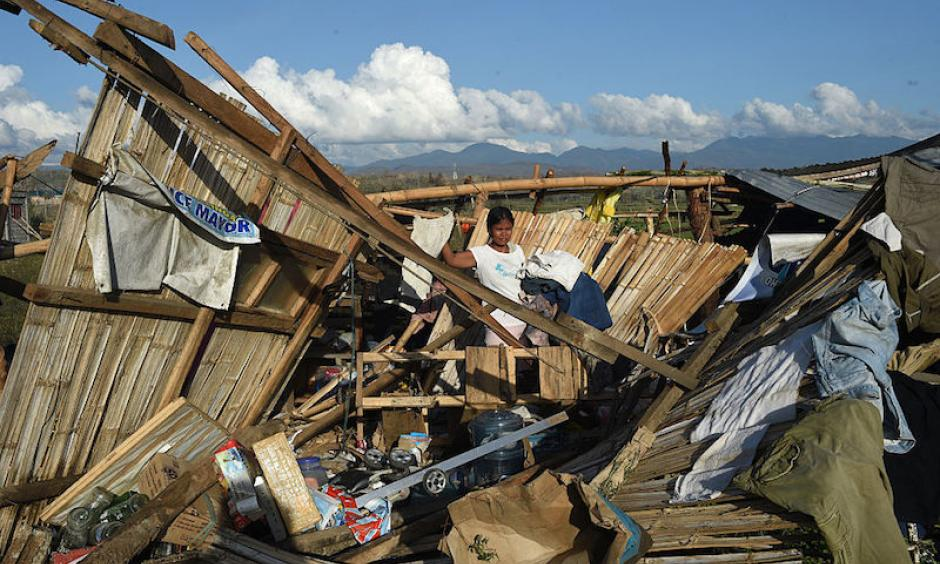 A resident of a home destroyed at the height of Typhoon Haima in Cabagan town, Isabela province, north of Manila on October 21, 2016. Cabagan and nearby areas on the east side of coastal mountains took the hardest hit from Hamia's Category 4 winds. Image: Ted Aljibe/AFP/Getty Images