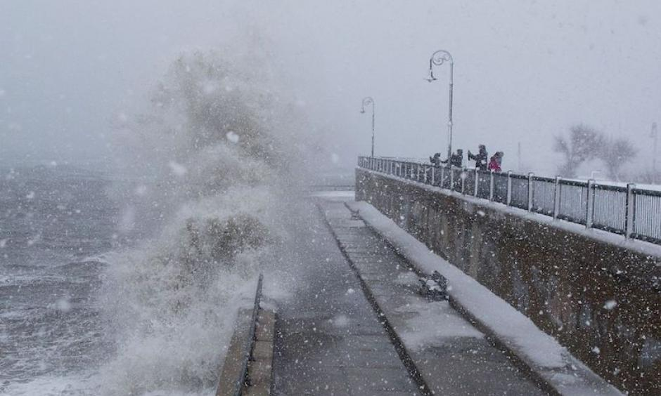 People watch as waves crash over the seawall along Lynn Shore Drive as Stella bears down on Lynn, MA, on Tuesday, March 14, 2017. Photo: Scott Eisen, Getty Images