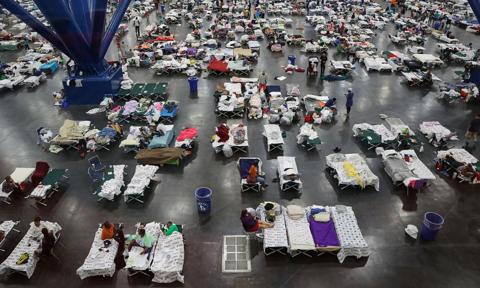 Evacuees fill up cots at a shelter set up inside the George R. Brown Convention Center in Houston, Texas. Photo: Joe Raedle, Getty Images