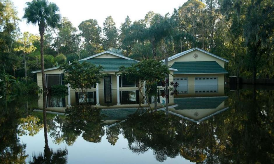 Floodwaters from the Alafia River flood homes in a neighborhood in the wake of Hurricane Irma on September 12, 2017 in Valrico, Florida. Photo: Brian Blanco, Getty Images