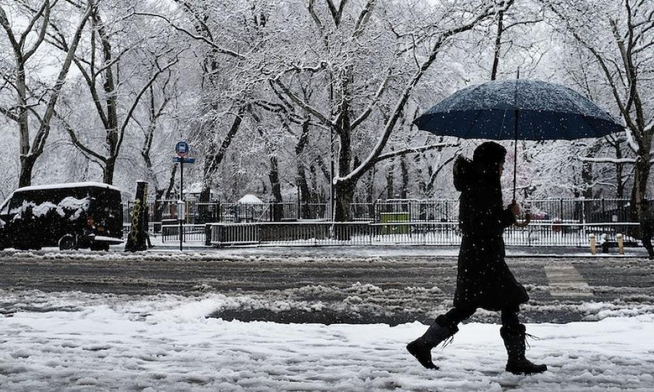 "A pedestrian walks in the morning snow during an early spring storm on April 2, 2018 in New York City. The daily snowfall total of 5.5"" in Central Park was the heaviest for any April day since 1982 and the seventh heaviest one-day April snow in records going back to 1869. Photo: Spencer Platt, Getty Images"