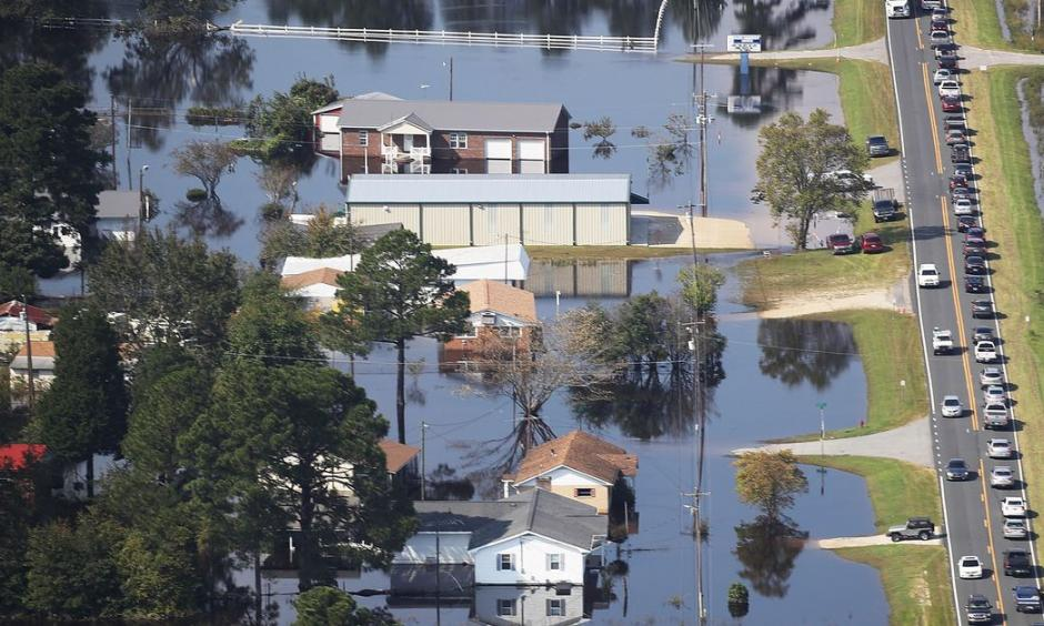 Floodwaters are seen surrounding homes after heavy rains from Hurricane Florence on September 20, 2018, in Lumberton, North Carolina. The rainfall from Hurricane Florence was a 1,000-year event. Photo: Joe Raedle, Getty Images