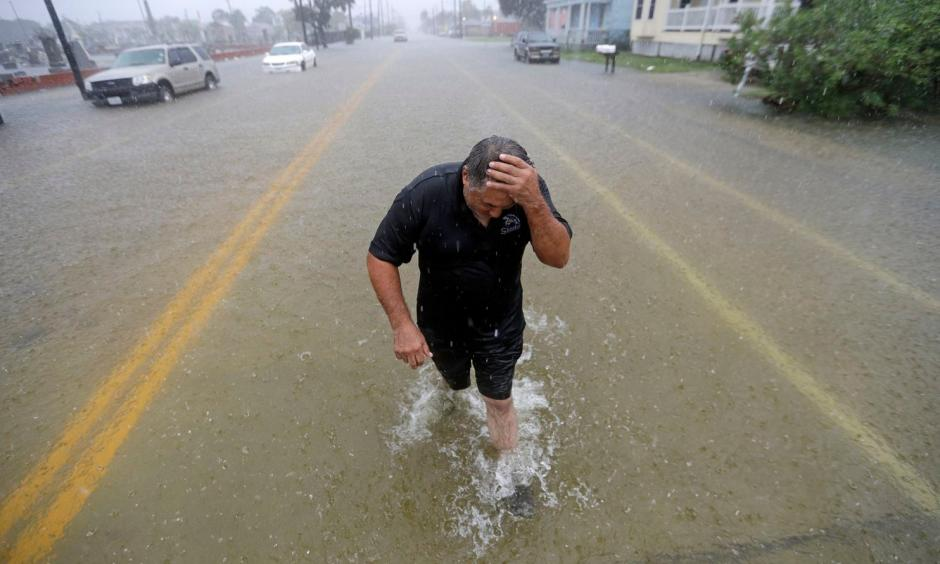 Angel Marshman wades through floodwaters from Tropical Depression Imelda after trying to start his flooded car on Sept. 18 in Galveston, Tex. Credit: David J. Phillip, AP
