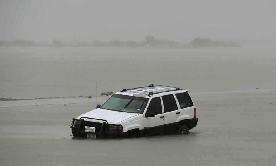 A car is partially submerged after Harvey hit Corpus Christi. Photo: Mark Ralston, AFP/Getty Images