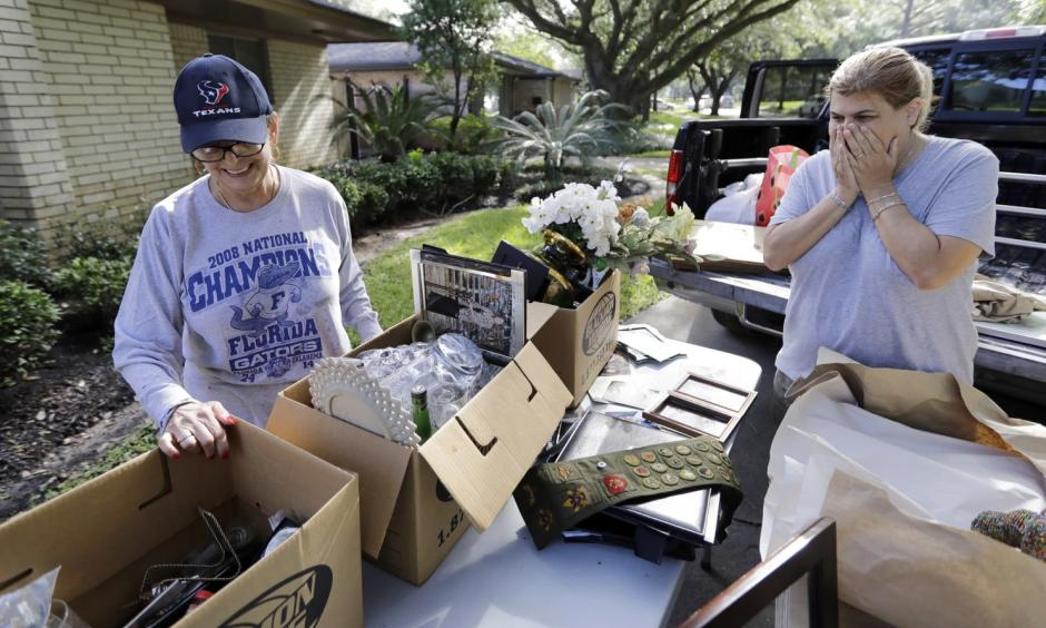 Judy Mellon, left, is helped by her daughter, Beth Kendrick, as she sorts through items damaged by floodwaters from Hurricane Harvey in Houston. Photo: David J. Phillip, AP