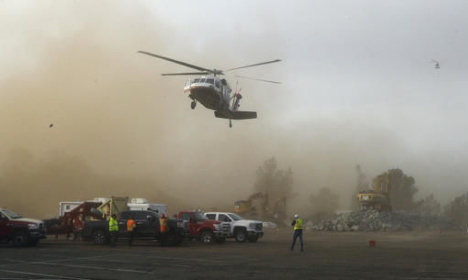 A helicopter kicks up dust as it lands at a staging area near the Oroville Dam on Monday, February 13, 2017. Photo: Rich Pedroncelli