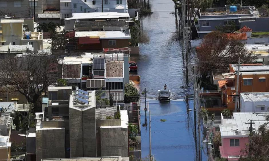 A flooded street in San Juan, Puerto Rico after Hurricane Maria. Photo: Joe Raedle | Getty Images