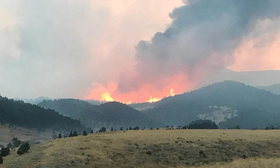 Fires blaze from the Blacktail Fire, located in the Blacktail Creek area, east of Loco Mountain in the Crazy Mountains, in Montana. The Blacktail Fire engulfed a little over 5,000 acres, with over 1 million acres impacted across Montana through various wildfires.