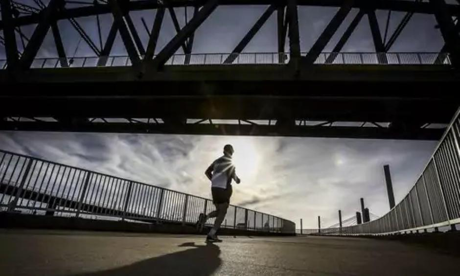 A runner makes his way up the circular path to the Big Four Pedestrian Bridge on February 14, 2017. Photo: Michael Clevenger, CJ