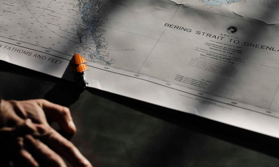 Polar maritime lawyer Scott Joblin, from the Australian National University in Cambria, looks over a map aboard the Finnish icebreaker MSV Nordica as it sets sail in the North Pacific Ocean toward the Bering Strait, Thursday, July 6, 2017. Photo: David Goldman, AP