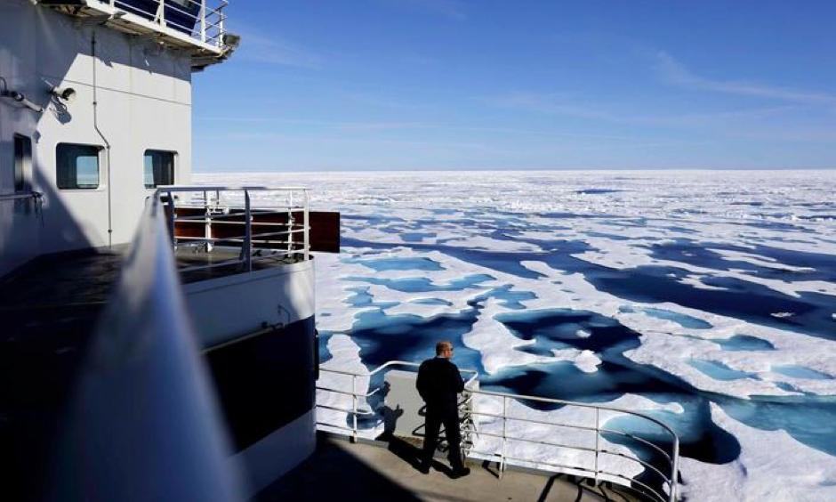 Canadian Coast Guard Capt. Victor Gronmyr looks out over the ice covering the Victoria Strait as the Finnish icebreaker MSV Nordica traverses the Northwest Passage through the Canadian Arctic Archipelago on July 22, 2017. Photo: David Goldman, AP
