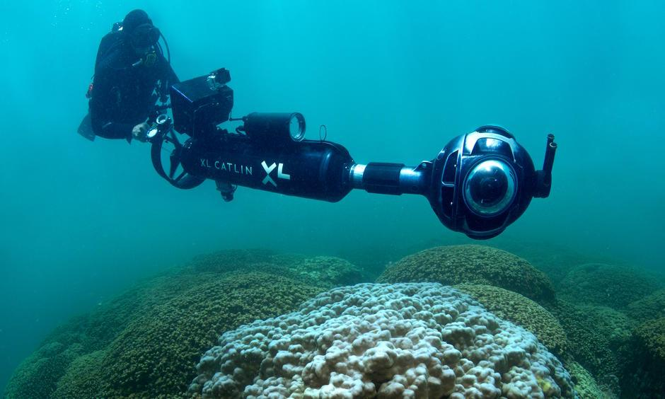 The XL Catlin Seaview Survey deployed a rapid response team to capture images of coral bleaching as it was happening in Hawaii and Florida. The photo shows Manuel Gonzalez recording the bleaching in Hawaii in 2015 using the SVII camera. Photo: XL Catlin Seaview Survey