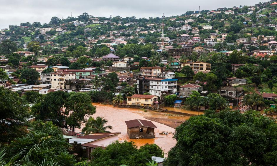 A house in Freetown was surrounded by water. Some homes were submerged, and many buildings were flattened altogether. Photo: Jane Hahn, New York Times