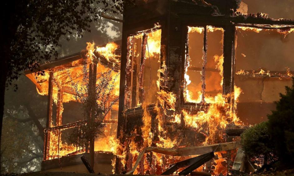 Flames consume a home as an out of control wildfire moves through the area, Oct. 9, 2017, in Glen Ellen, California. Photo: Justin Sullivan, Getty Images