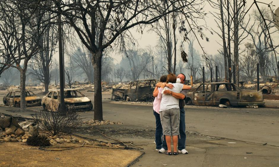 Neighbors Tina and Art Anaya hugged Lisa Coats in the streets of their neighborhood in Santa Rosa on Monday. Photo: Jim Wilson, The New York Times