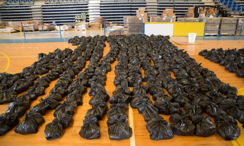 Supplies are gathered in a gymnasium in Barranquitas, Puerto Rico, October 28, 2017. Photo: Nydia Melendez, Puertoflash