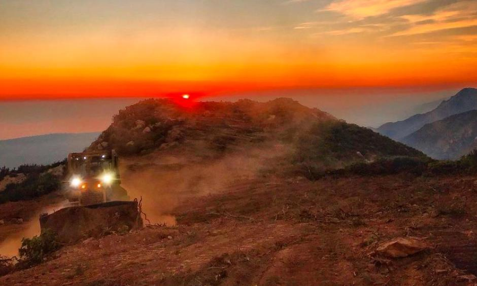 A dozer from the Santa Barbara County Fire Department clears a fire break across a canyon from atop Camino Cielo down to Gibraltar to make a stand should the fire move in that direction. Photo: Mike Eliason, Santa Barbara County Fire Department via AP