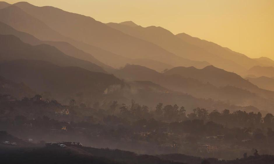 The sun rises as fire crews prepare for another day of fighting the Thomas fire in Montecito on Sunday. Photo: Marcus Yam, Los Angeles Times
