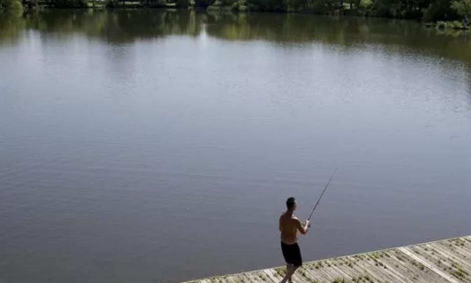 Hugh Poole fishes at a pond in FDR Park in Philadelphia, Thursday, May 24, 2018. Photo: David Maialetti, AP