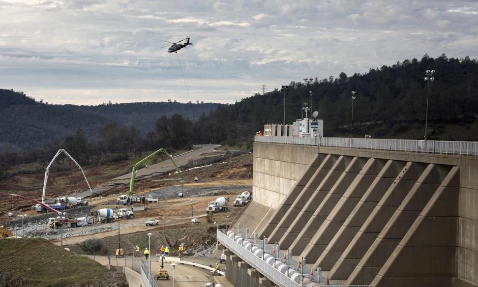 Reconstruction continued Wednesday in a race to shore up the emergency spillway, left, at the Oroville Dam. Photo: Brian van der Brug, Los Angeles Times