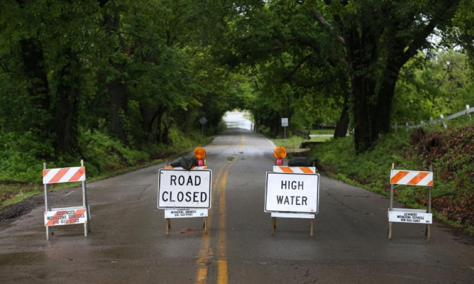 High water signs block a flooded stretch of 81st Street near Elwood Avenue in Jenks, Okla., on Saturday, April 29th, 2017. Photo: Matt Barnard, Tulsa World