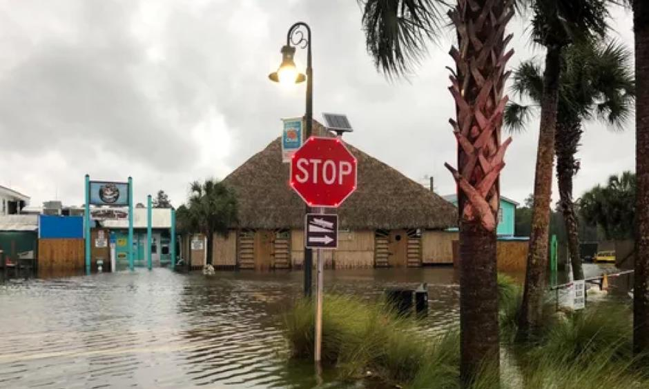 The St. Marks River overflows into the city of St. Marks, Fla., ahead of Hurricane Michael on Oct. 10, 2018. Photo: Brendan Farrington, AP