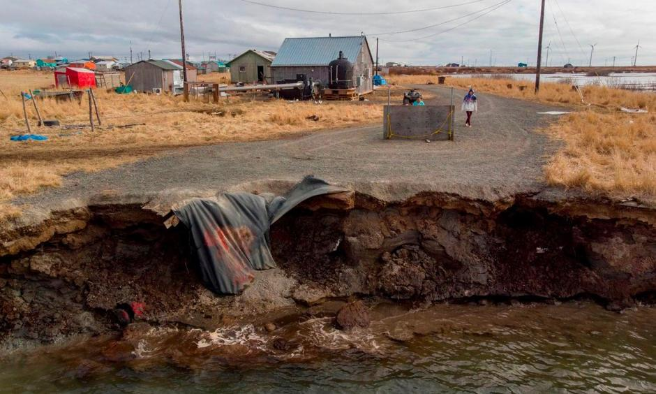 Climate change erosion caused by melting permafrost tundra and the disappearance of sea ice which formed a protective barrier, threatens houses from the Yupik Eskimo village of Quinhagak on the Yukon Delta in Alaska last month. Photo: Mark Ralston, AFP