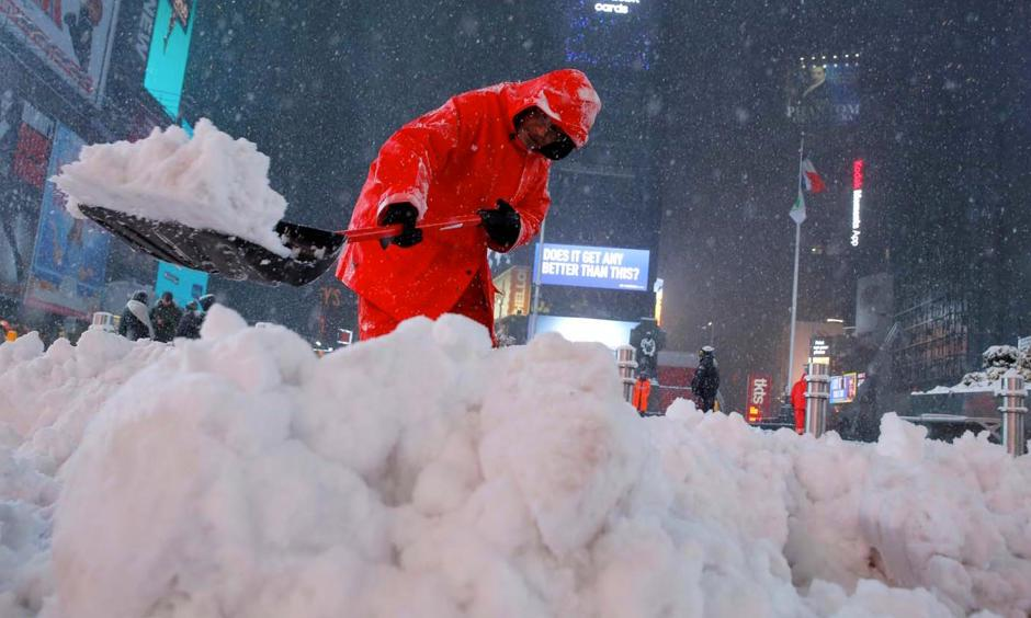 A worker clears snow in Times Square in New York City, on March 14, 2017. Photo: Andrew Kelly, Reuters