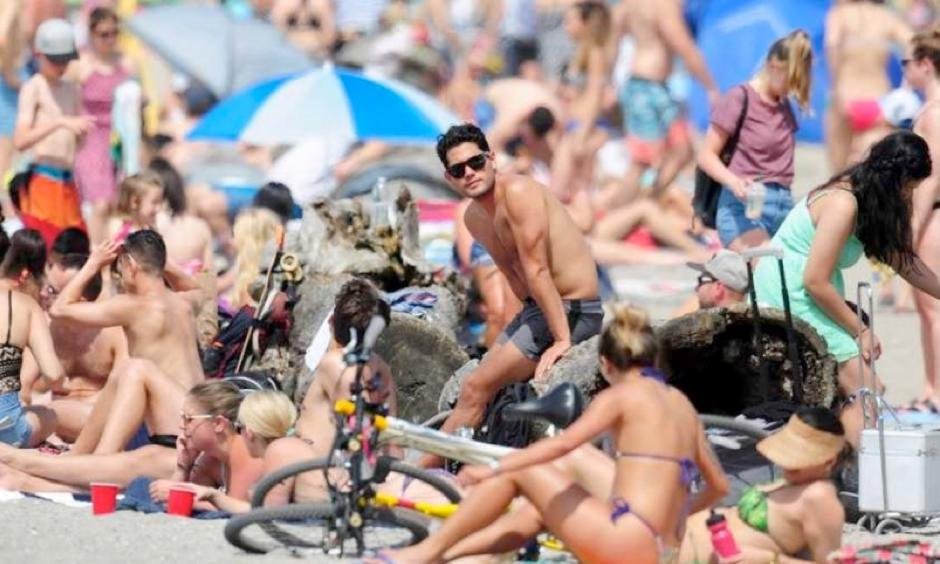 Sun seekers pack Kits Beach in Vancouver on Sunday as temperatures neared record highs. Photo: Nick Procaylo