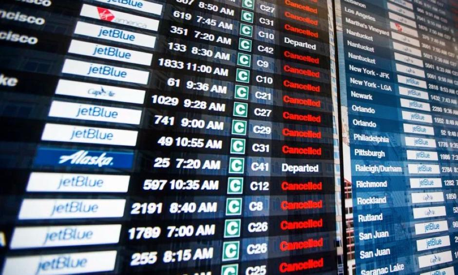 The information board in Terminal C at Logan International Airport shows the majority of flights canceled during Winter Storm Stella in Boston, on March 14, 2017. Photo: Scott Eisen, Getty Images