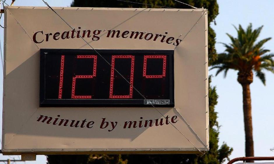 A local temperature sign reads 120 degrees as temperatures climb to near-record highs Tuesday, June 20, 2017, in Phoenix. Photo: Ross D. Franklin