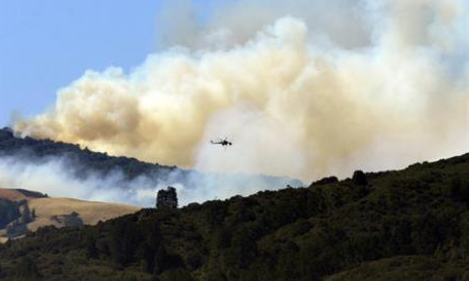 A wildfire burning for nearly two months on California's Central Coast has surpassed $200 million in firefighting costs, becoming the costliest to fight in U.S. history. Data from the National Interagency Fire Center released Monday, Sept. 19, 2016, says the so-called Soberanes fire has cost $206.7 million to fight so far. Photo: David Royal / The Monterey County Herald via AP