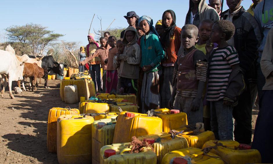 In February 2016, villagers gather at the Ula Arba water point, in Ziway Dugda Woreda, Arsi zone Oromia region, Ethiopia. Photo: Charlotte Cans, OCHA