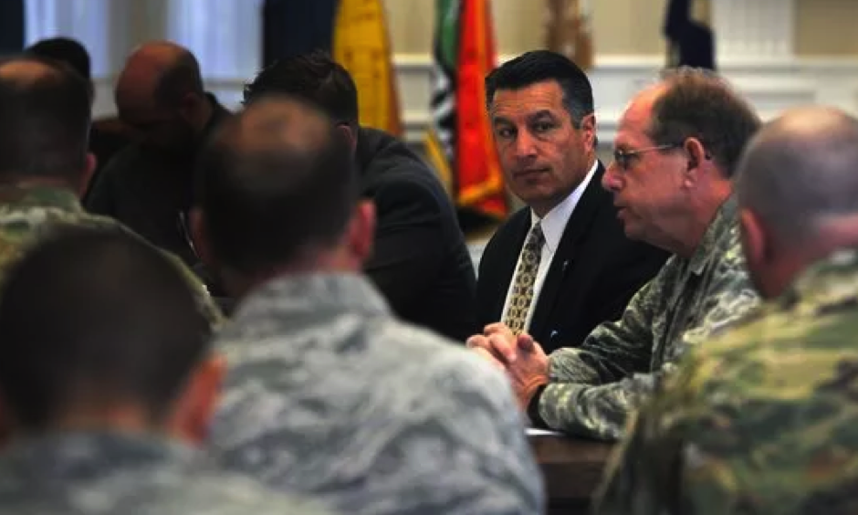 Governor Brian Sandoval, middle, listens to Brigadier General William Burks of the Nevada National Guard, right, speak during a briefing on possible spring flooding at the Old Assembly Chambers in the Nevada State Capital Building in Carson City on April 13, 2017. (Photo: Jason Bean, Reno Gazette Journal, USA Today Network