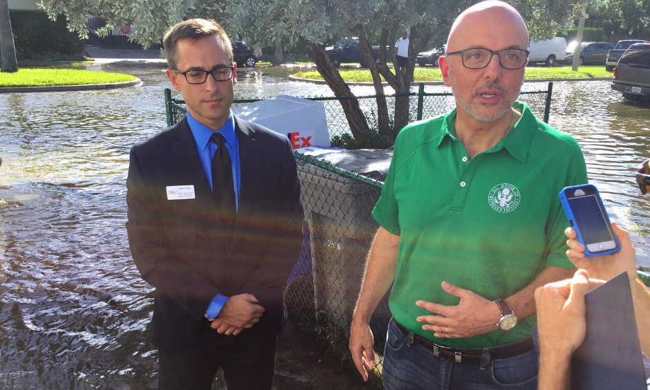 U.S. Representative Ted Deutch wades through tidal flooding in Fort Lauderdale on Oct. 17, 2016. Photo: Peter Haden, WLRN