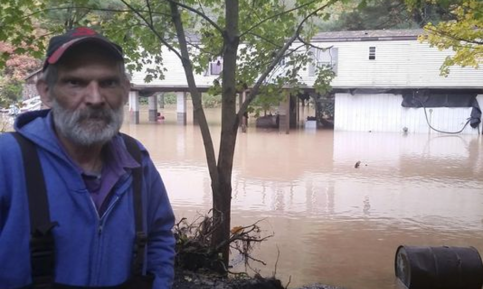 Sheb Brown, o fTrout Run, Pa., stands behind his elevated home on McIntyre Way, as flood waters surround it Friday morning, OCt. 21, 2016. Freak storms packing up to 100 mph winds hit Pennsylvania early Friday, sending floodwaters into hundreds of homes and causing a pipeline rupture that dumped more than 50,000 gallons of gasoline into a stream, threatening drinking water supplies. Photo: Philip A. Holmes, Sun-Gazette via AP